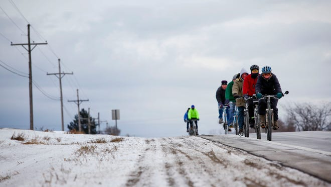 Cyclists ride on Peck Road in Lexington during 2014's New Year's Day Bike Ride.