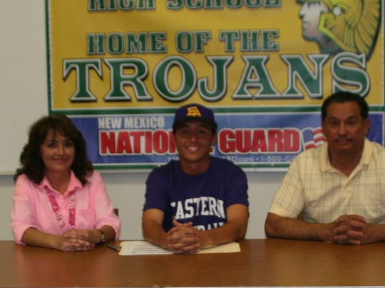 Mayfield's Martin Morales, center, signed to play baseball at Eastern Arizona College this weekend. Morales is pictured with his parents Julian and Ofelia Morales.