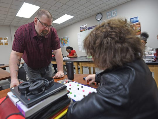 Jim Jameson works with one of his students Tuesday