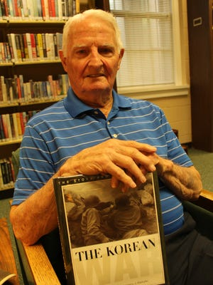 Korean War veteran John Sherrer of Selma holds a history of the conflict that claimed nearly 40,000 American lives 67 years ago. It began on June 25, 1950. Alvin Benn/Special to the Advertiser