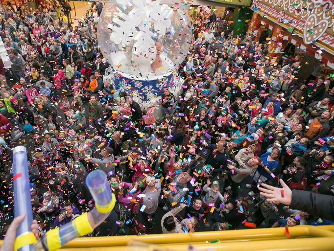 Confetti heads toward revelers during the annual early