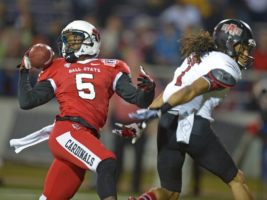 Ball State cornerback Eric Patterson (5) breaks up a pass intended for Arkansas State wide receiver Julian Jones (7) in the first quarter of the GoDaddy Bowl NCAA college football game, Sunday, Jan. 5, 2014, in Mobile, Ala.