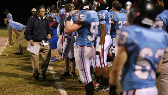 USJ head coach Mickey Marley encourages his players on the sideline during a game at home this season. Marley will no longer coach football at USJ. That decision is the most memorable story in West Tennessee sports in 2015, according to the Sun sports staff.