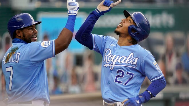 The Kansas City Royals' Adalberto Mondesi (27) celebrates with teammate Maikel Franco (7) after his solo home run during the first inning of a baseball game against the Detroit Tigers at Kauffman Stadium in Kansas City, Mo., on Sept. 26, 2020.