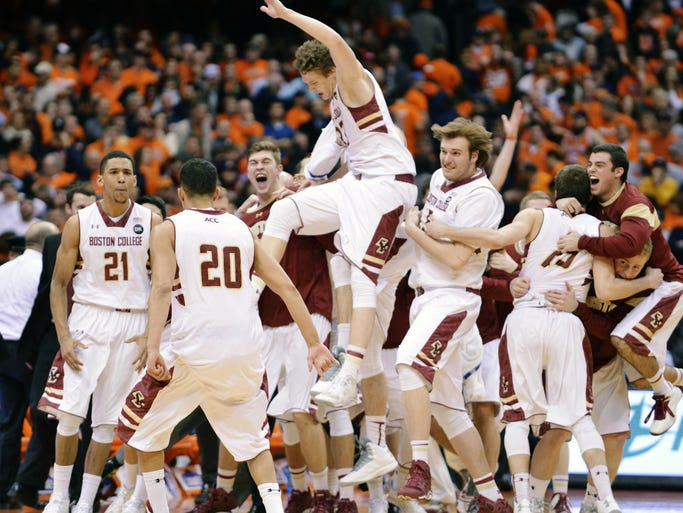 Feb 19, 2014; Syracuse, NY, USA; The Boston College Eagles bench celebrates after beating the Syracuse Orange at the Carrier Dome 62-59 in overtime. Mandatory Credit: Mark Konezny-USA TODAY Sports