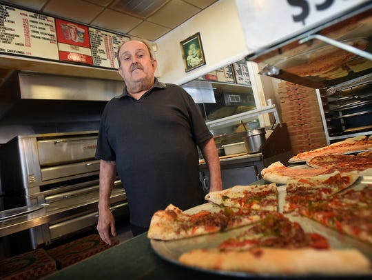 Pete Martorana, the owner of Pete's Pizza, stands inside