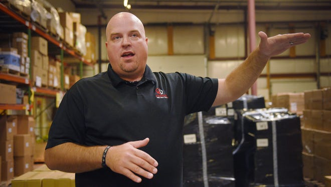 Weisser Distributing director of operations Jason Reisdorfer talks about how they have expanded their storage space over the years, in this 2017 file photo. Weisser Distributing was named to the Inc. 5000 list of fastest growing private businesses in the nation, one of 11 in South Dakota