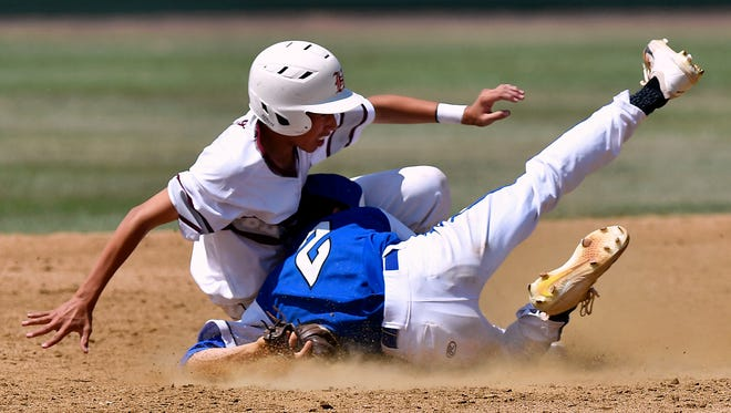 Stamford pitcher Zach Duran slides into Hawley baserunner Caleb Comer on Saturday at Hardin-Simmons University's Hunter Field. Comer was safe on the play. The Bearcats rallied for five runs in the bottom of the seventh inning to win 11-10 and take the playoff series.