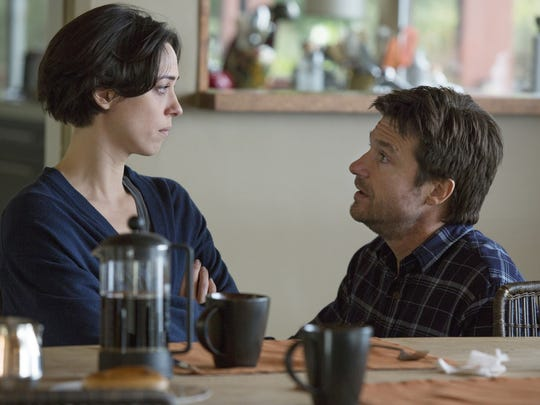 """This photo provided by STX Productions LLC shows, Rebecca Hall, left, and Jason Bateman, in a scene from the film, """"The Gift."""" The movie opens in US. theaters on Aug. 7, 2015.  (Matt Kennedy/STX Productions, LLC via AP)"""