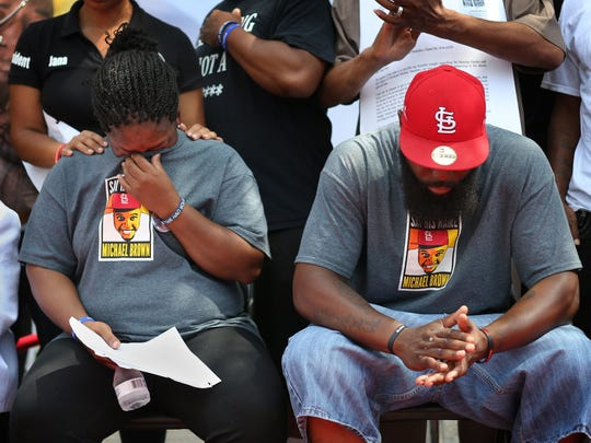 Cal Brown, left, and her husband Michael Brown, Sr. get emotional during a memorial ceremony for Brown's son Michael Brown on Canfield Drive in Ferguson, Mo., Tuesday, Aug. 9, 2016. August 9 marks the two year anniversary of Brown's fatal shooting by Ferguson police officer Darren Wilson. Brown's death sparked local protests that spread around the world and breathed live into the Black Lives Matter movement. A St. Louis County grand jury and an investigation by the Department of Justice found that Wilson was justified in shooting Michael Brown.