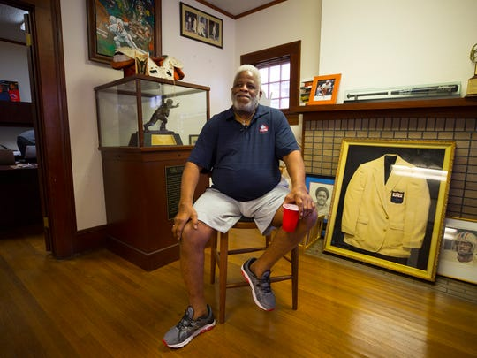 Campbell is surrounded by memorabilia of his athletic