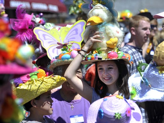 Lindsey Stack holds her flapping duck hat on her head before the Dillsboro Easter Hat Parade in 2012. The event is held annually on the Saturday before Easter.