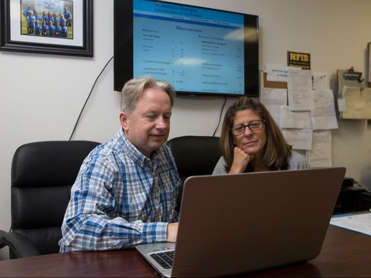 Joseph Wagner, president of JW2 Business Strategies, works with Lori Gindlin, office manager of his client, Splash Plumbing and Heating, based in Freehold.