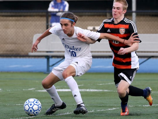 Whitefish Bay's Matthew Comiskey blocks Cedarburg's