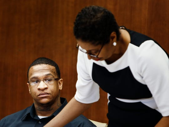 Quinton Tellis, 29, waits along side his defense attorney Darla Palmer (right) before his trial begins in a Batesville, Miss., courtroom, Wednesday, Oct. 11, 2017. Tellis, is charged wth burning 19-year-old Jessica Chambers to death almost three years ago on Dec. 6, 2014. Tellis has pleaded not guilty to murder.