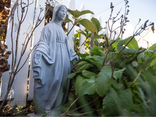 Ralph and Patricia Florio had a statue of the Virgin Mary displayed in front of their home for years. It recently disappeared with no explanation. Similar statue in their garden.   Ocean Grove, NJThursday, November 2, 2017@dhoodhood