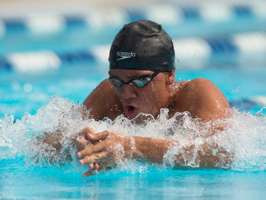Treasure Coast's Daniel Varon swims the 100-yard breaststroke