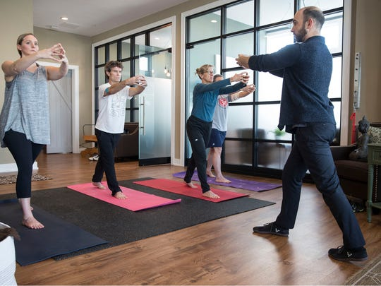 Kyle Kim of Integrative Wellness Group holds a class teaching people proper foundation of exercise. Belmar, NJWednesday, November 15, 2017@dhoodhood