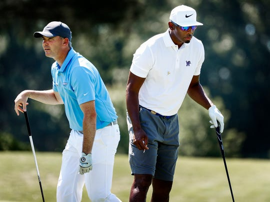 Memphis football coach Mike Norvell, left, and basketball coach Penny Hardaway on the third hole during the InnerWorkings Pro-Am at the FedEx St. Jude Classic at TPC Southwind on June 6, 2018.
