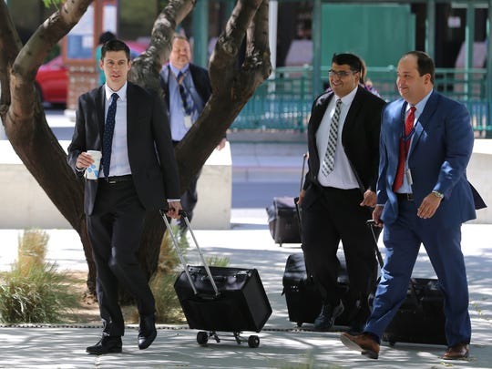 U.S. attorneys in June enter the federal courthouse for a hearing on the EPISD cheating scheme.