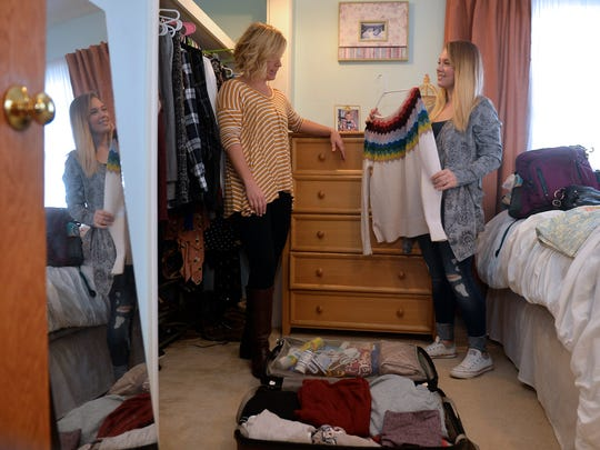 Corrina Dahlin talks about wardrobe choices with daughter, Ashlyn,  while Ashlyn packs for trip in November 2017.