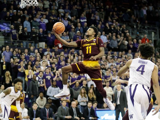 Arizona State guard Shannon Evans II (11) puts up a shot against Washington guard Matisse Thybulle (4) in the first half of an NCAA college basketball game, Thursday, Feb. 1, 2018, in Seattle. (AP Photo/Ted S. Warren)