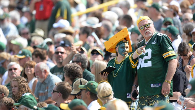 Green Bay Packers shareholders dress for the full stadium experience during the annual meeting at Lambeau Field.