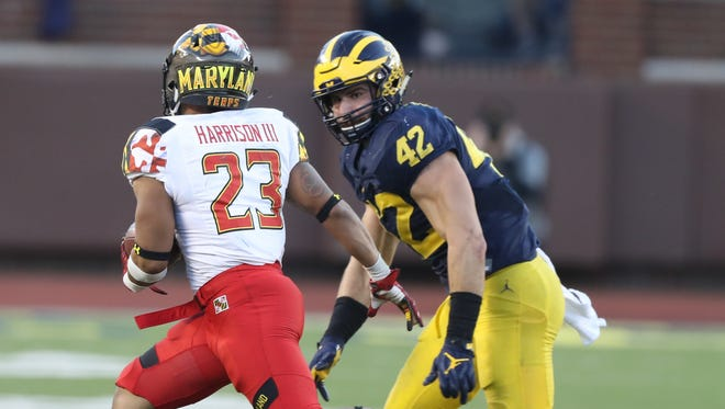 Michigan Wolverines' Ben Gedeon pursues Maryland Terrapins Lorenzo' Harrison during the second half Nov. 5, 2016 at Michigan Stadium.