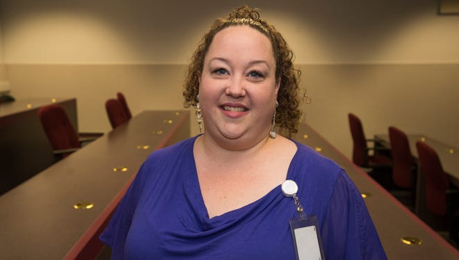 Katie Meyer won an Essence Award for her work as an operations coordinator in the circulation department.