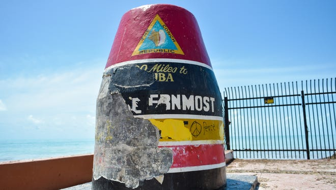 Layers of paint were stripped from the Southernmost Point marker in Key West by Hurricane Irma.