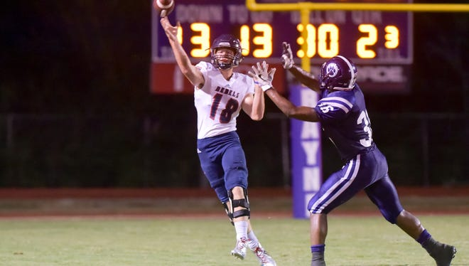 Quarterback Wesley Blazek throws a pass as The Rayne Wolves take on the Teurlings Rebels for Homecoming game. Friday, Oct. 6, 2017.