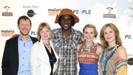 Burton and Stephanie Ritchie of Heretic Films (left), â??Tanzania: A Journey Withinâ? subjects Venance Ndibalema and Kristen Kenney and the filmâ??s director Sylvia Caminer pose for photographs at the filmâ??s Los Angeles premiere.