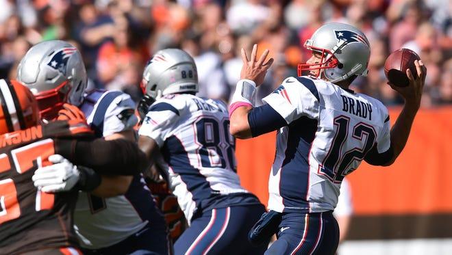 Patriots QB Tom Brady (12) threw three TD passes in his 2016 debut.
