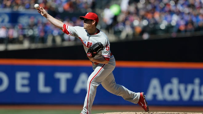 Phillies starting pitcher Jeremy Hellickson throws during the first inning of Sunday's game against the New York Mets at Citi Field.
