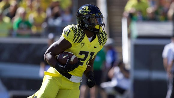 Sep 19, 2015; Eugene, OR, USA; Oregon Ducks running back Royce Freeman (21) runs the ball against the Georgia State Panthers at Autzen Stadium. Mandatory Credit: Scott Olmos-USA TODAY Sports