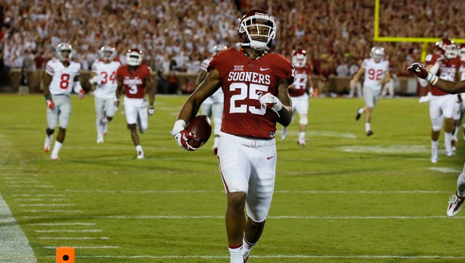 Oklahoma running back Joe Mixon runs into the end zone with a touchdown against Ohio State in Norman, Okla., on Saturday, Sept. 17, 2016.