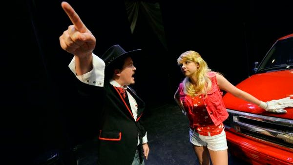From left, Daniel Marlatt, playing Mike Ferris, and Hannah Smith, playing Heather Stovall, rehearse a scene from Centre Stage's upcoming show 'Hands on a Hardbody' on Monday, August 18, 2014.