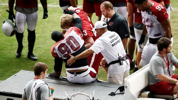 Cardinals defensive tackle Darnell Dockett was carted off the field Monday afternoon after suffering what appeared to be a right leg injury.
