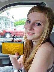 This photo of Leigh Spicer was taken in May of 2016, when she received the new Nintendo Gameboy 3DS XL. Leigh was an expert gamer and loved Zelda games.