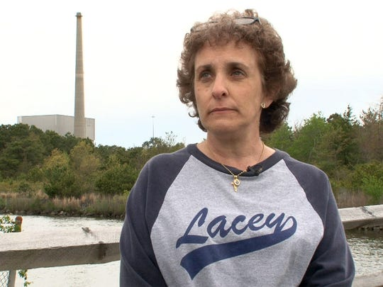 Lacey Township resident Regina Discenza is shown during a Thursday afternoon, May 11, 2017, interview in the township.  She expressed concern about the town's tax rate when the Oyster Creek Nuclear Plant (shown in the background) closes.