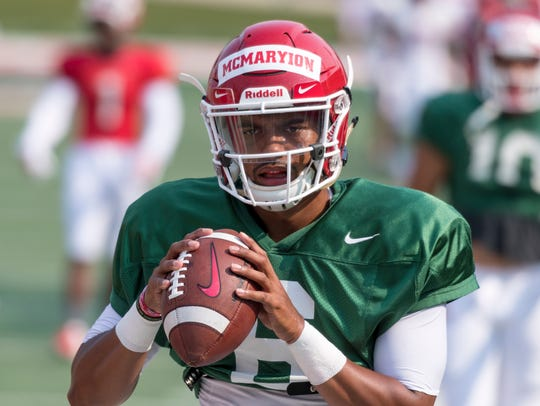 Quarterback Marcus McMaryion practices with the Fresno
