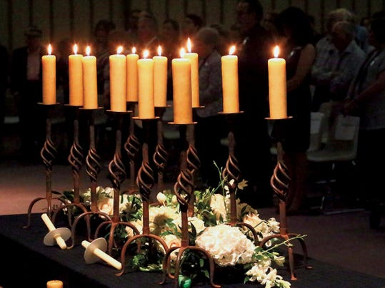 Rudy Gutierrez—El Paso Times Rememberance candles are lit during the Holocaust Days of Rememberance program Sunday at Temple Mount Sinai.