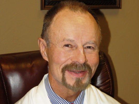 Dr. Michael Spence M.D.