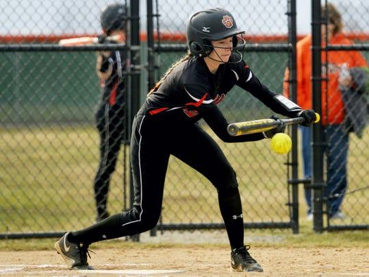 Central York's Alyssa Stonebreaker bunts for a single, allowing teammate Monica Albers to score in the fourth inning Thursday at Central York. Central York defeated Red Lion, 12-1, in five innings.