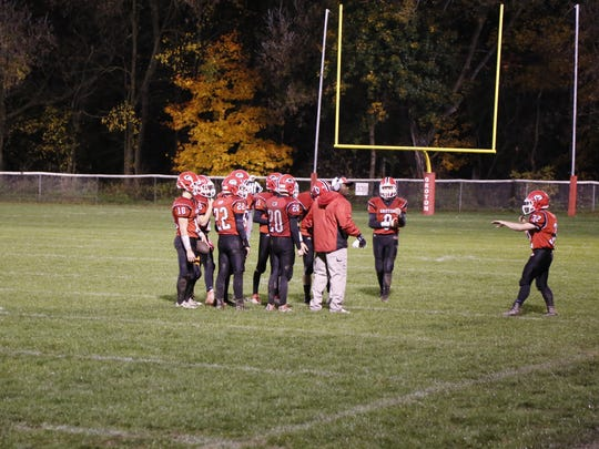 The Groton defense huddles up to discuss strategy on Friday against Tioga.