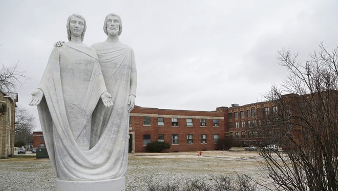 A statue of Saint Joseph the Educator and Jesus on the campus of Saint Joseph's College Friday, January 27, 2017, in Rensselaer. Financial challenges at the Catholic college, which has an enrollment of about 1,200 students, may force the school to close.
