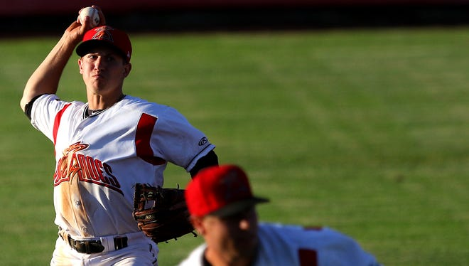Volcanoes shortstop Christian Lichtenhaler looks to throw to first base against Tri-City at Volcanoes Stadium, on Tuesday, July 7, 2015, in Keizer, Ore.