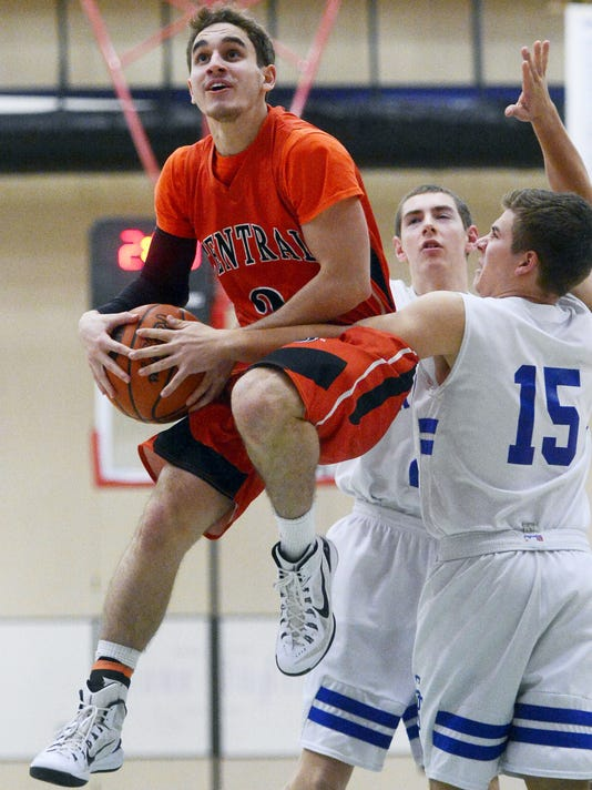 Central York's Peter Falci is fouled by Spring Grove's Luke Hoffnagle during the boys' basketball game at Spring Grove Area High School Tuesday, February 3, 2015. Central York won 67-38.  Kate Penn -- Daily Record/Sunday News