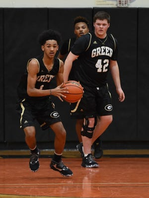 Rising seniors Cameron Woodruff, left, a guard, and Ryan Pearson (42), a post player, are two of 12 returnees for Greer High's boys basketball team.