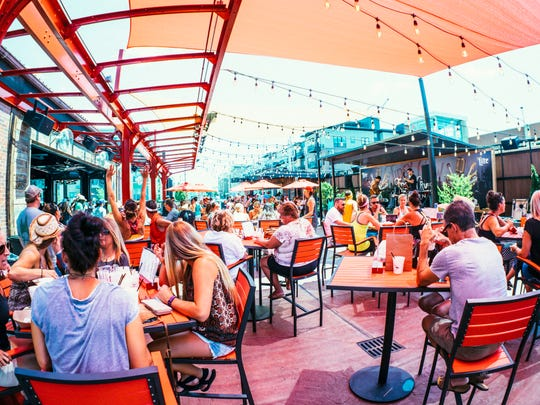 The packed patio area at the Tipsy Crow Tavern.